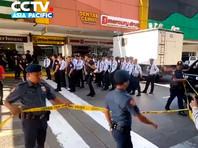 На Филиппинах уволенный охранник взял в заложники 30 посетителей торгового центра (ВИДЕО)