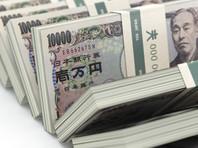 Власти Японии решили раздать деньги всем жителям страны из-за эпидемии