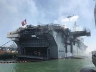 На горящем третий день десантном корабле США обрушилась взлетная палуба
