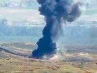 Кадр видео удара по позициям азербайджанских войск в Нагорном Карабахе