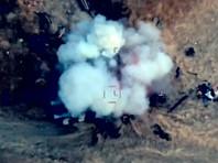 Кадр видео удара азербайджанской армии по позициям войск Нагорного Карабаха