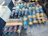 В Индонезии перехвачена партия контрабанды -  попугаи в бутылках
