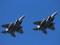 По словам пресс-секретаря Министерства обороны Джона Кирби, авиаудар был нанесен двумя истребителями F-15 по объектам ополченцев, расположенным у города Абу-Кемаль на границе с Ираком