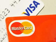 Объем платежей по кредитным и дебетовым банковским картам в 2016 году во всем мире составит 23,2 трлн долларов и впервые в истории превысит общую сумму покупок за наличные (22,6 трлн)