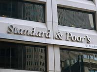 """S&P: рейтинг России останется на """"мусорном"""" уровне еще пару лет"""
