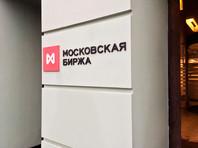 """Доллар США и евро уверенно растут на """"Московской бирже"""" в понедельник утром: рубль снижается к бивалютной корзине на фоне снижения интереса инвесторов к валютам развивающихся рынков"""