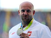 Польский метатель диска продаст медаль Олимпиады, чтобы помочь больному ребенку