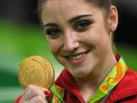 Алия Мустафина заполучила олимпийское золото в упражнениях на брусьях