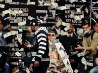 Мэйвезер забросал деньгами Макгрегора на пресс-конференции перед боем