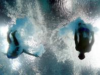 Участники чемпионата мира по водным видам спорта замерзают в прыжковом бассейне