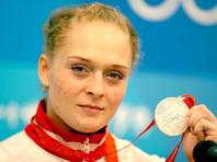 Тяжелоатлетка Оксана Сливенко спустя девять лет станет олимпийской чемпионкой Пекина