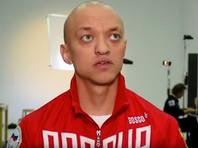 Пауэрлифтера отстранили от соревнований за демонстрацию портрета Путина