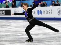 Михаил Коляда (Россия) выступает в произвольной программе мужского одиночного катания в финале Гран-при по фигурному катанию в японской Нагое
