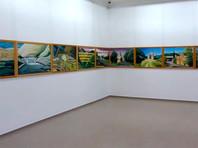 """Немецкий художник дописывает самую длинную картину в мире под названием """"Картина мира"""" - 190 метров"""