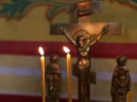 В Белгороде молодую маму, прикурившую от свечи в церкви, оштрафовали на 15 тысяч рублей