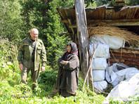 Отшельница-старовер Агафья Лыкова молится за Тулеева, передвигающегося в инвалидной коляске
