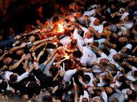 Благодатный огонь сошел к верующим в храме Гроба Господня в Иерусалиме