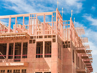 Минстрой готовит нормативные акты, которые позволят строить в России многоэтажные дома из дерева