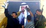Шииты заменили в Багдаде портрет Саддама портретом Имама Хусейна