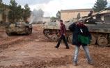В Ливии страшные бои. Каддафи объявил себя британской королевой и пропал