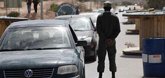 В Нигер прибыли 10 машин с золотом Каддафи