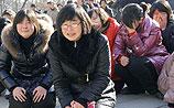 КНДР провожает Ким Чен Ира: люди рыдают на улицах, а ведущая - в эфире (ВИДЕО)