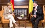 Меркель призвала Украину к перемирию, а Россию - к переговорам