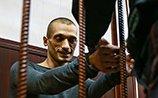 Павленский потребовал судить его за терроризм. Акциониста взяли под стражу на 30 суток