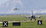 Военные пилоты США и России провели трехминутные учения в небе над Сирией